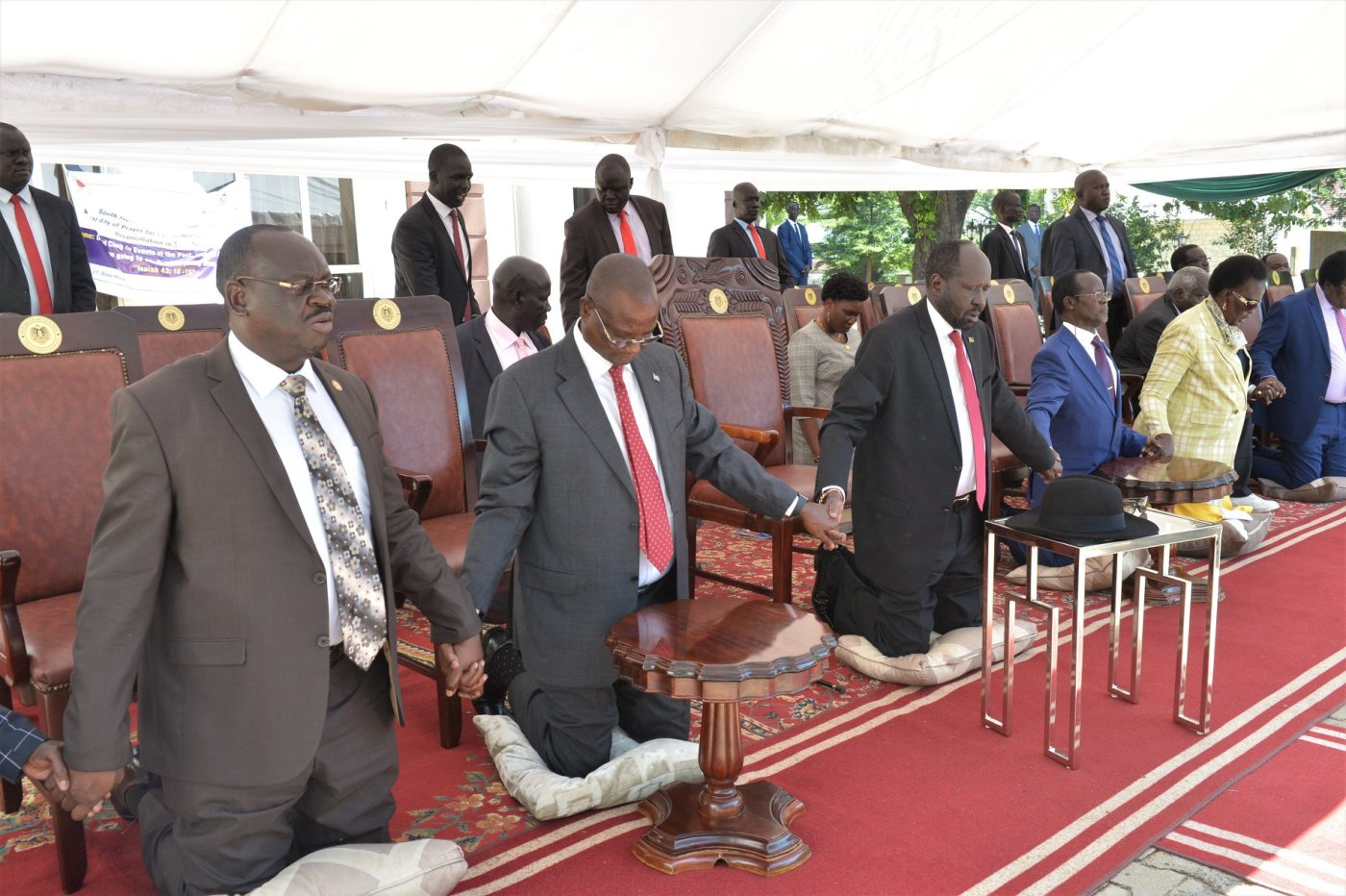 Leaders holding hands during the prayers meeting in J1(Photo credit: Nyamilepedia)