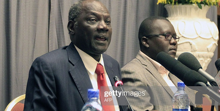 South Sudan Minister for Information and Broadcast, Michael Makuei (C) gives a press conference on January 5, 2014 alongside other delegation members in the Ethiopian capital a day after South Sudan's warring parties met in Addis Ababa for the first time since fighting erupted three weeks ago. The army continued Saturday to battle rebels in a bid to wrest back the strategic town of Bor, capital of Jonglei, one of the country's largest states. Heavy fighting was also reported late Saturday near the presidency in the capital Juba. AFP PHOTO/Solan GIMECHU (Photo credit should read SOLAN GEMECHU/AFP via Getty Images)