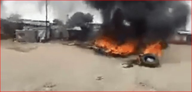 A group of protesters burning a tire in South Sudan capital after a gunman, identified as a nephew of President, killed 5 people and injuried several others(Photo credit: Nyamilepedia)