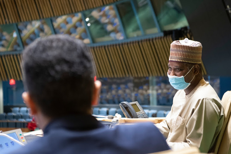 Tijjani Muhammad-Bande (right), President of the seventy-fourth session of the United Nations General Assembly, presides over the elections. At left is Movses Abelian, Under-Secretary-General for General Assembly and Conference Management (Photo credit: UNITED NATIONS)