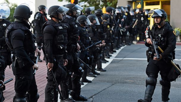 Police seen patrolling streets in the US as violence surge over the death of black man George Floyd in June 2020 (Photo credit: Getty Images)