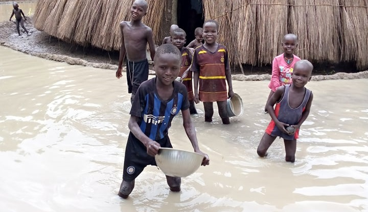 Children playing inside water after floods in Panyijiar county of Unity state (Photo credit: CPA)