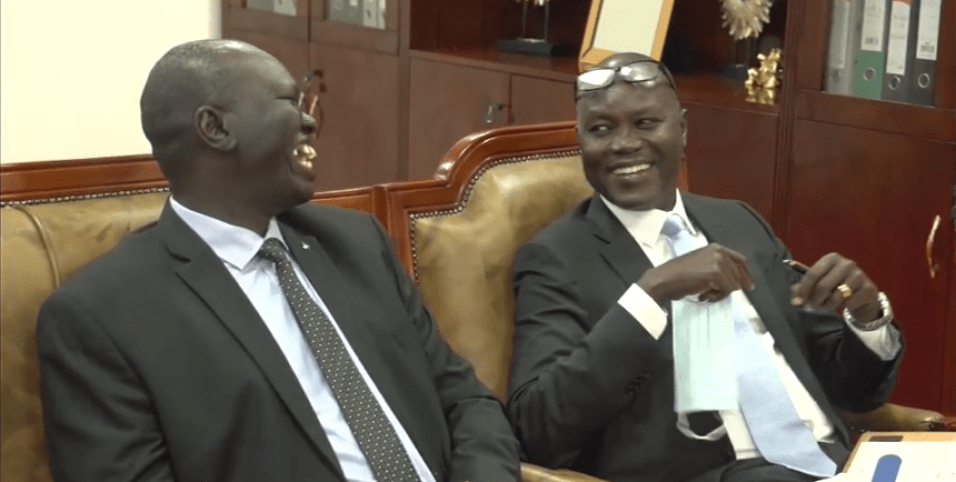 New minister of finance, Hon. Athian Diing Athian, exchanging laughters in Dr. Machar office on Friday, September 25, 2020(Photo credit: Nyamilepedia)