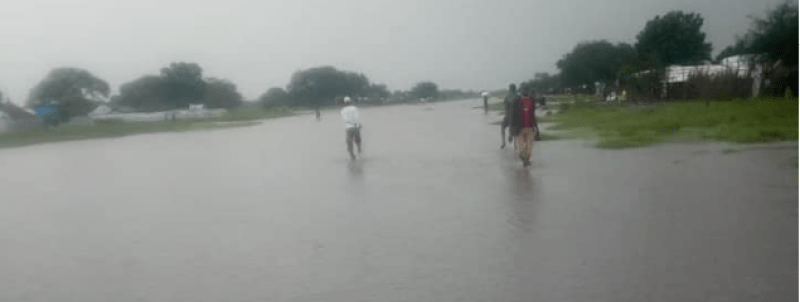 Residents of Ayod county walking in a flooded airstrip in Ayod county(Photo credit: supplied)