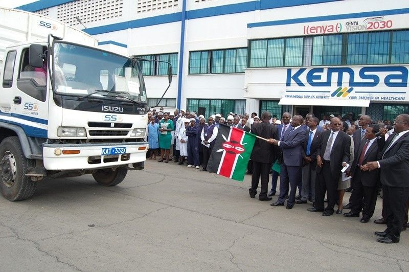 Kenya medical supplies authority officials raising a flag while receiving a procurement(Photo credit: supplied)
