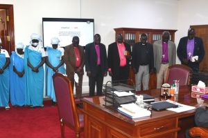 Religious leaders led by Moderator Peter Gai Lual praying for Dr. Rielk Machar in his office in Juba, South Sudan(Photo credit: OoFVP/Nyamilepedia)