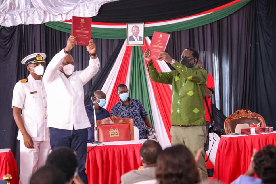 President Uhuru Kenyatta and Opposition leader Rt. Hon Raila Odinga showing off the BBI Report they receive on Oct 21, 2020(Photo credit: Raila Odinga office)