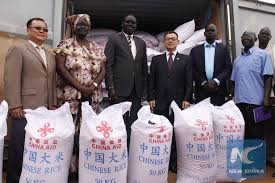 Chinese officials handing over sacks of Chinese rice to South Sudan government officials(Photo credit: courtesy image/Nyamilepedia)
