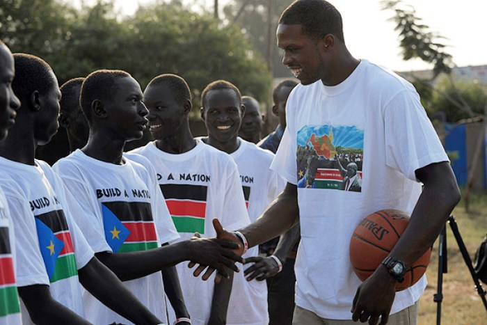Luol Deng greeting a local team in Juba, South Sudan(Photo credit: courtesy image/Nyamilepedia)