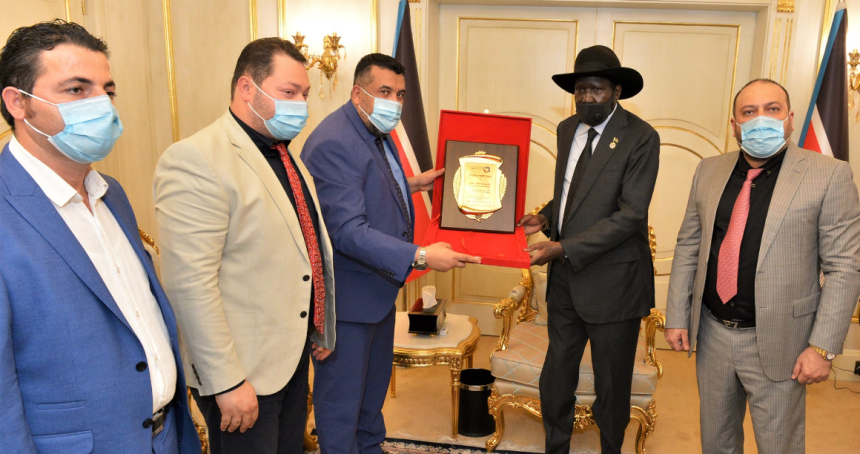Dr. Muhammad el-Arab from Peace without Borders Organization presenting a peace medal to president Salva Kiir on December 1st, 2020(Photo credit: Courtesy image/Nyamilepedia)
