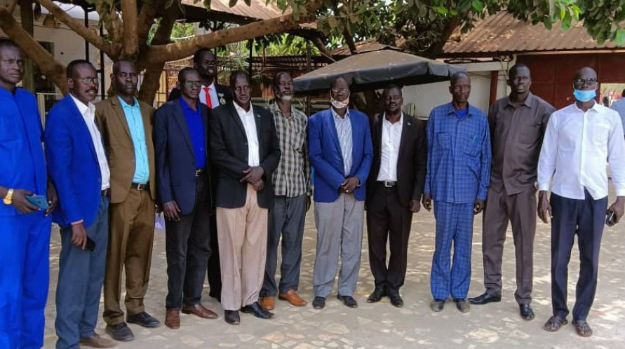 Ex-officials posting for a group photo before matching to J1 with hopes to demand their unpaid arrears. They were denied entry upon arrival(Photo credit: file)