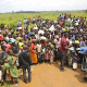 Asylum-seekers from the Democratic Republic of the Congo wait for health screening near the border in Zombo, Uganda.(Photo credit: UNHCR/Rocco Nuri)