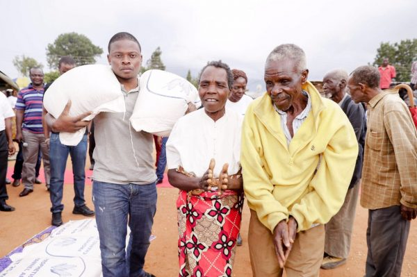 Pictorial Focus Of Prophet Bushiri Giving Maize In Malawi