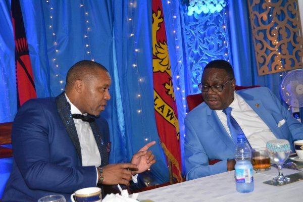 President Mutharika have a talk with Vice President Saulos Chilima at the DPP blue night