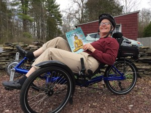 "J.E. enjoying her HP Velotechnik Gekko fx recumbent trike while reading a magazine called ""Tricycle."""