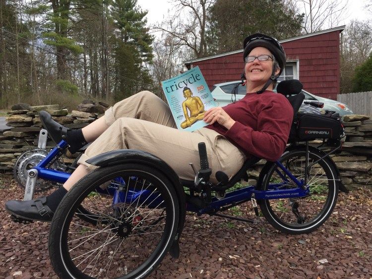 "Customer/friend J.E. enjoying her HP Velotechnik Gekko fx recumbent trike while reading a magazine called ""Tricycle."""
