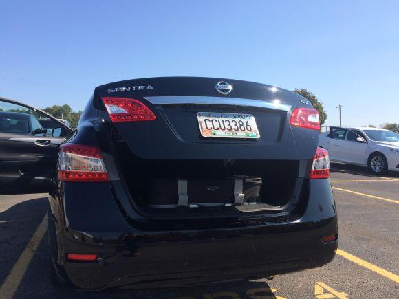 Grasshopper fx/Air shown in the trunk of an economy rental car.