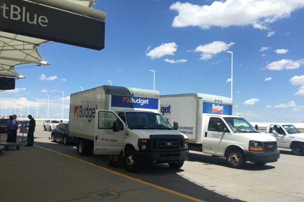 Trucks rented by Bags, Inc for Walmart convention attendees. Photo by Paul Thompson.