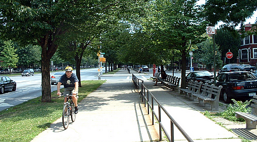 Separated bike path, pedestrian path, and seating on Ocean Parkway