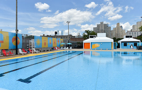 View from the deck of lounge chairs and brightly-painted walls at Douglas and Degraw Pool