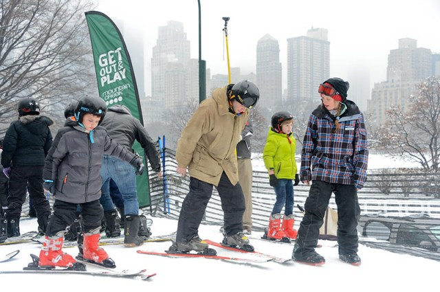 Kids and their families learn how to ski.