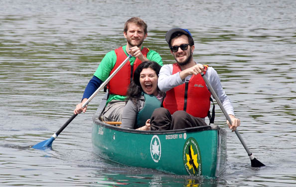 guests enjoy paddling in a canoe