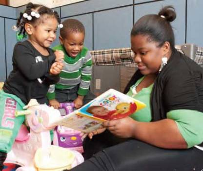 A young mother reads to her children. With help from the Mildred Anna Williams Fund, she was able to get vital services.