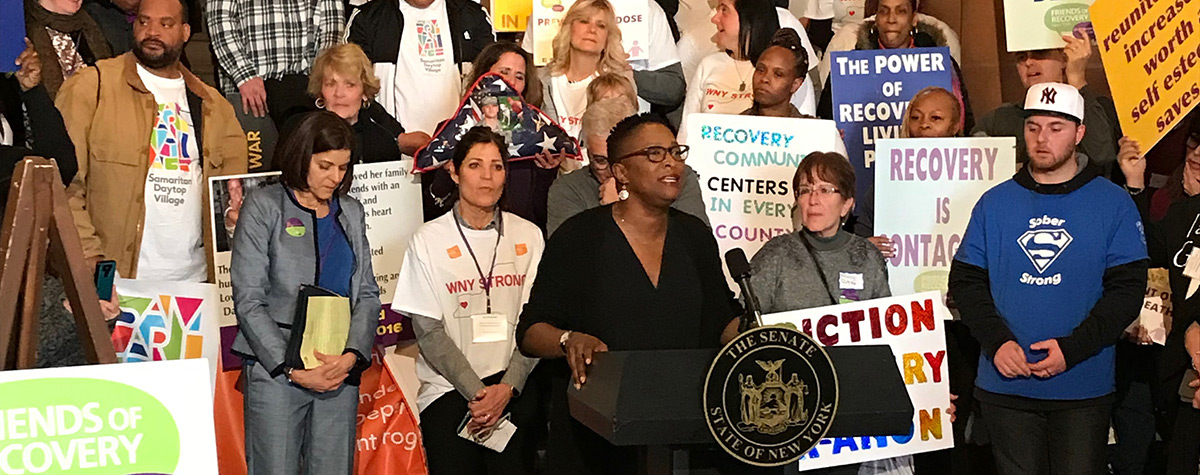 FUNDING RECOVERY: Tracie Gardner of Legal Action Center speaks at an Albany press conference about consumer rights and parity for addiction treatment.