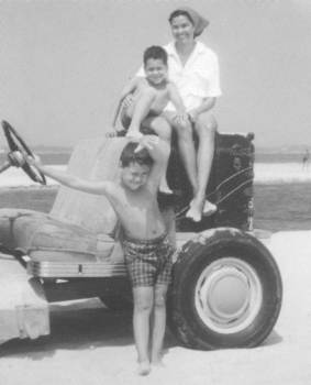 Barbara with her sons at the beach