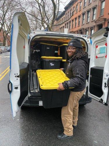 Roger Nunez unloading a van