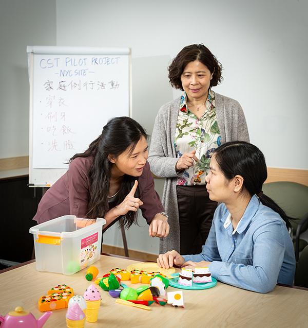 A Chinese educator speaking to a young girl.