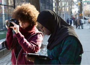Two girls participating in a photography program