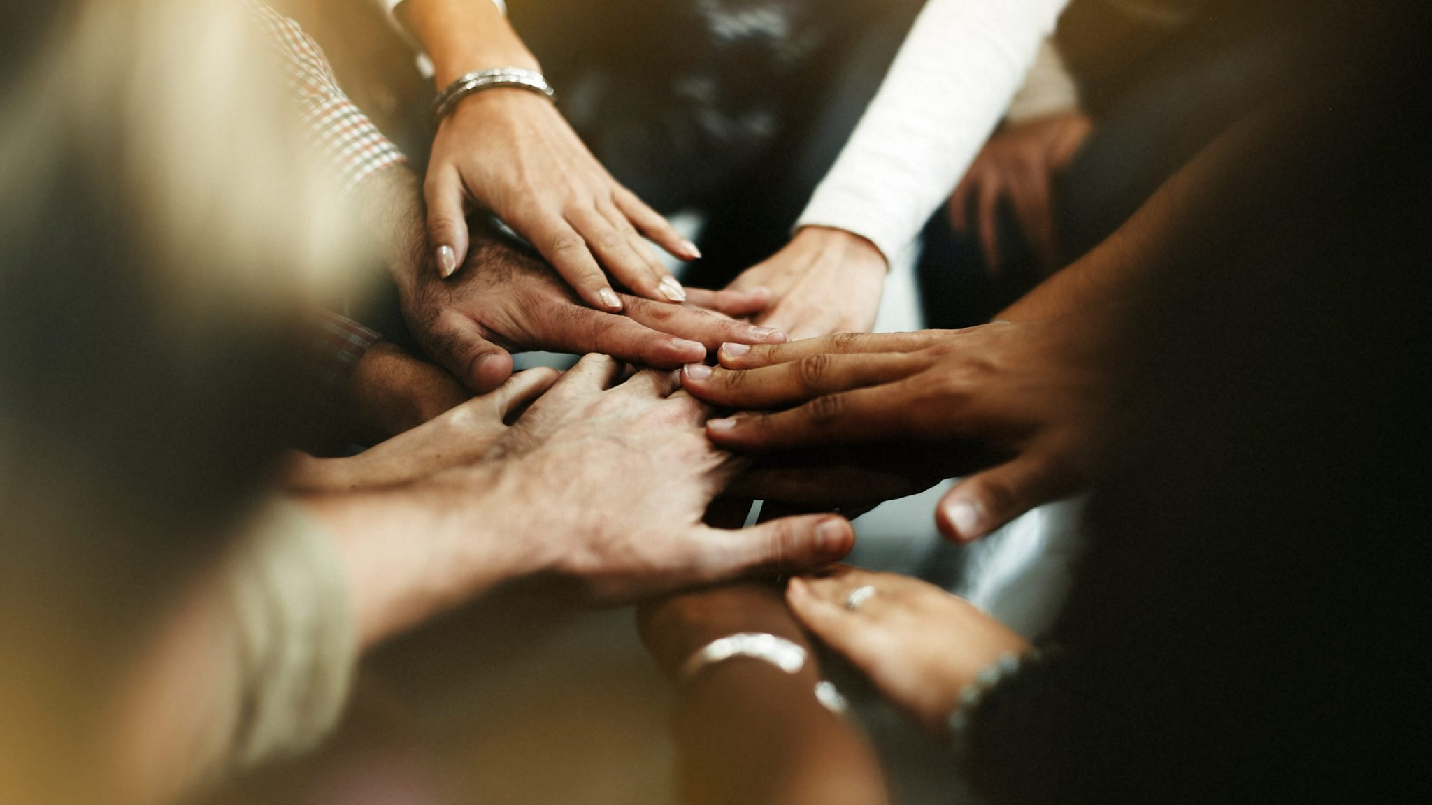 Closeup,Of,Diverse,People,Joining,Their,Hands