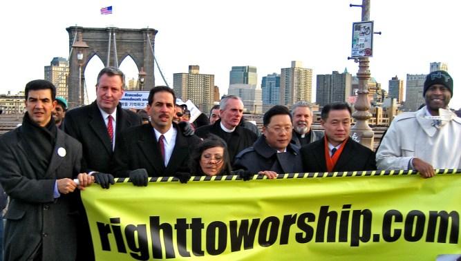 Bill DiBlasio, Fernando & Elvia Cabrera, John Liu marching across Brooklyn Bridge to City Hall. Photo: Christopher Smith/A Journey through NYC religions