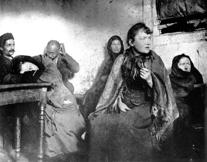 Hell on earth. Homeless women sit all night in unheated basement dives. Photo: Jacob Riis
