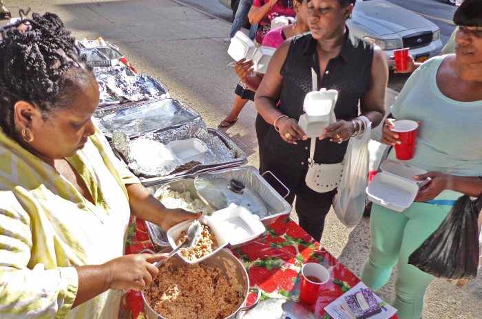 Picking up some church take-out food. Photo: Melissa Kimiadi/A Journey through NYC religions