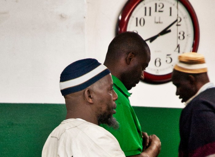 Africans gather at the clock for prayers at Masjid Noor Islam in Highbridge, Bronx, NY. Photo: Tony Carnes/A Journey through NYC religions