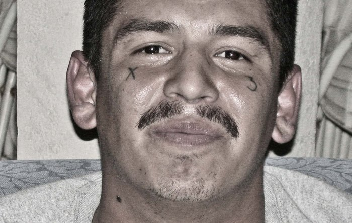 """The family of this very violent gangster nailed shut the door to his room, though they still allowed him to visit his room according to strict protective ground rules set by the court. After trying unsuccessfully to shoot a cop so that he would also die, """"suicide by cop,"""" he ended up being mentored by Victory Outreach. He was so on the edge of violent explosion when I interviewed him, I didn't give him much chance of staying alive. Amazingly, when I checked up on him over the years, I found that he was still out of the gang life. Photo: Tony Carnes/A Journey through NYC religions"""