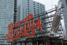 This March 7, 2013 photo shows the bright red Pepsi-Cola sign on the waterfront of Long Island City, in the Queens borough of New York. The beloved landmark can be seen from across the river in Manhattan. At one time the sign was located at the site of a local soda bottling factory. The factory no longer exists but the popular sign, which dates to the 1930s, was preserved as part of a waterfront park called Gantry Plaza State Park. In the distance the Ed Koch Queensborough Bridge and the smokestacks of a power generating plant are visible. The area is becoming popular with tourists due to a boom there in moderately priced hotels.(AP Photo/Beth J. Harpaz)