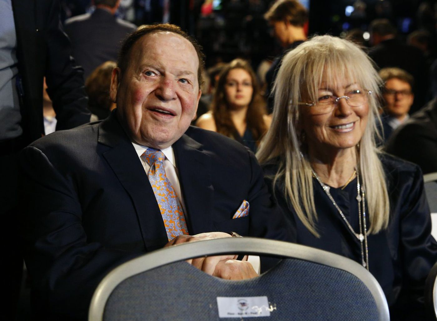 Sheldon Adelson sits with his wife Miriam.