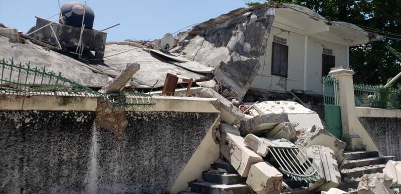 The residence of the Catholic bishop is damaged after an earthquake in Les Cayes, Haiti, Saturday, Aug. 14, 2021.