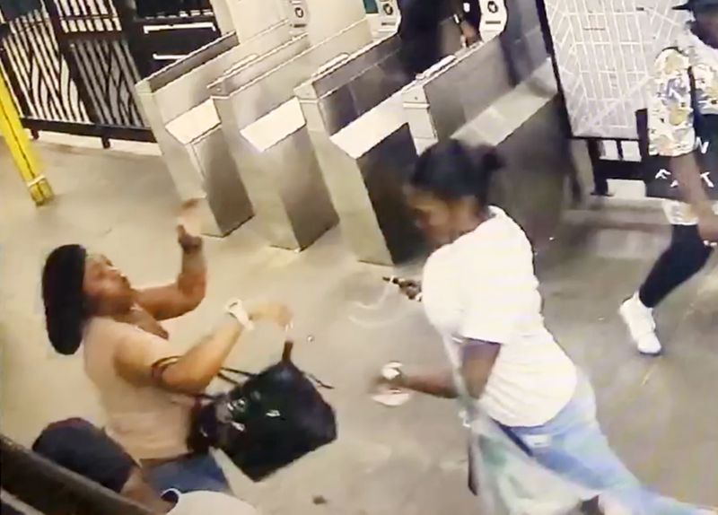 Mia Simmons (right in white) got into a fight with victim Latanya Watson (left in beige) on a Manhattan-bound No. 3 train about 9:45 p.m. Monday. Both women got off at the Sutter Ave. station in Brownsville, where the showdown escalated in the mezzanine after the victim pepper sprayed Simmons as they walked through the turnstile, cops said. The brawl ended with 30-year-old Watson fatally stabbed.