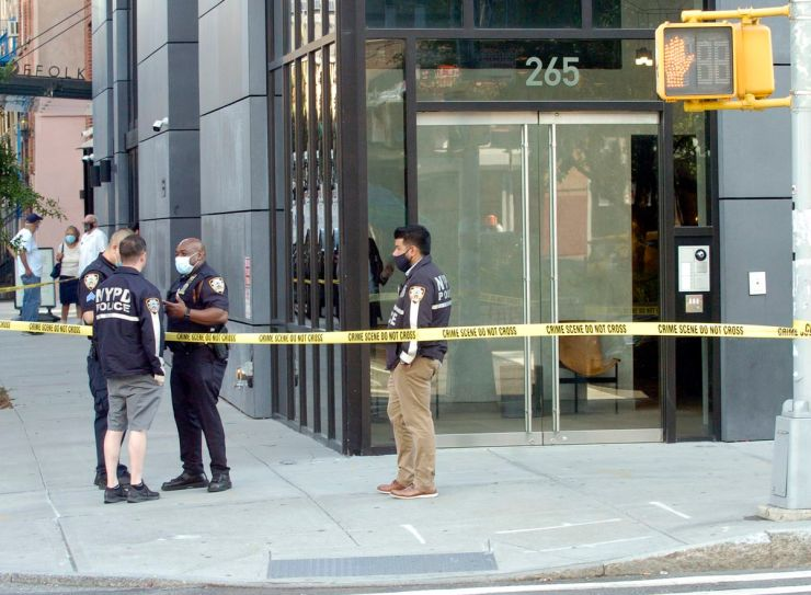NYPD outside the scene where a limbless and headless torso was found on East Houston St. in Manhattan.