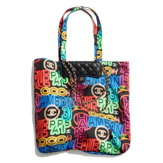 Multicolour bag in printed fabric and removable clutch in grained leather