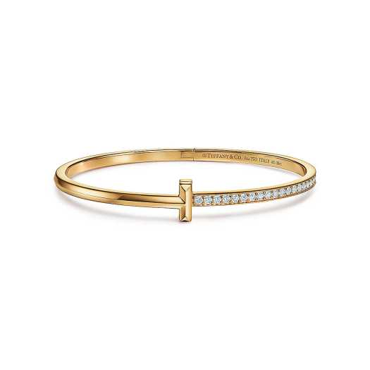 TIFFANY T:T1 NARROW DIAMOND HINGED BANGLE, $9,500 | Our cultural obsession with Tiffany & Co. somehow didn't end once the famous Holly Golightly scene faded in front of our eyes. Every girl, in her deepest of hearts, yearns for something Tiffany, which is why we had to include this 18k gold icon, studded with round brilliant diamonds.
