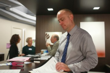 At the Welcome Desk-President Bryan Callahan & board member Anthony Lagattuta in the background, assisting participants