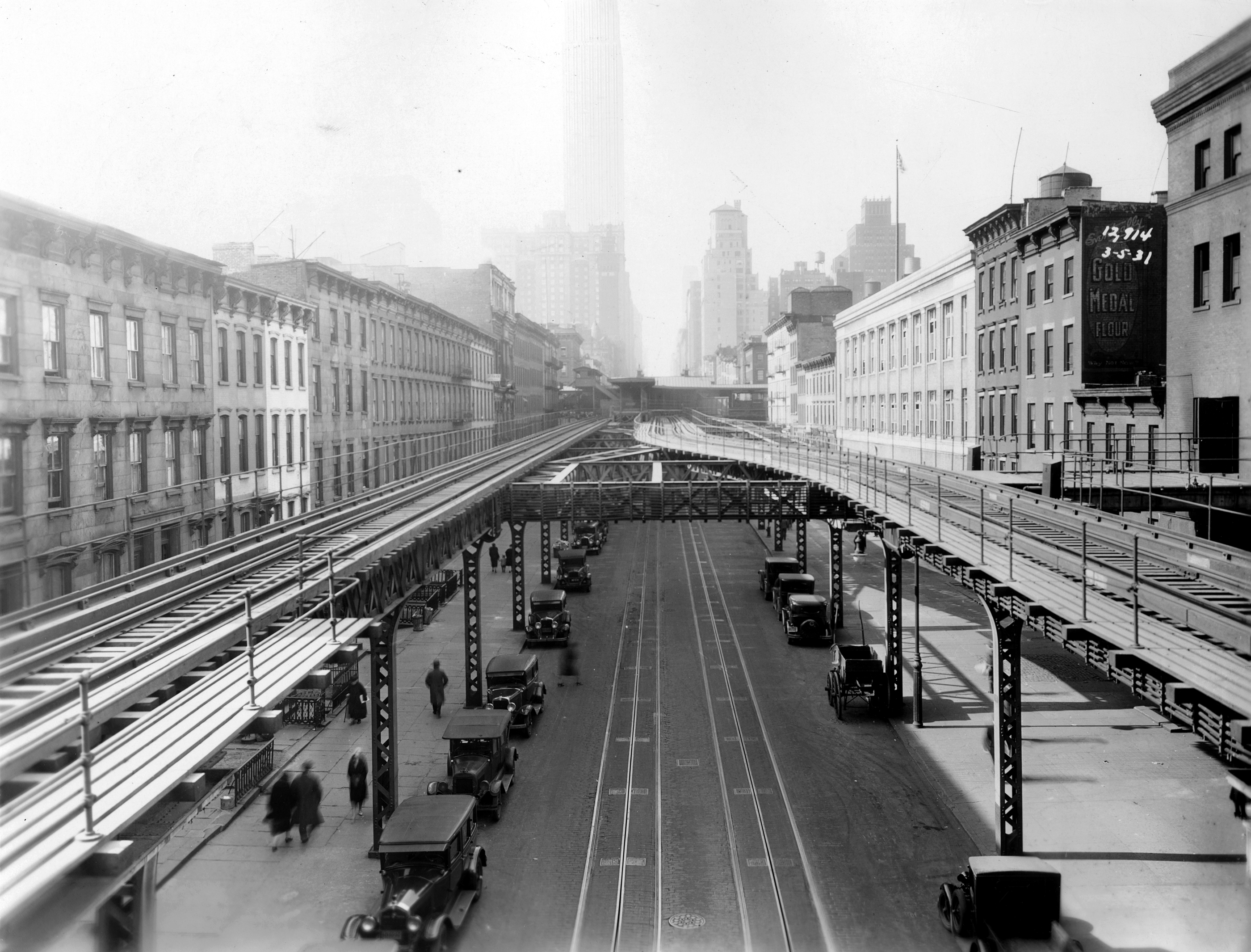 View of Third Avenue with elevated train structures visible