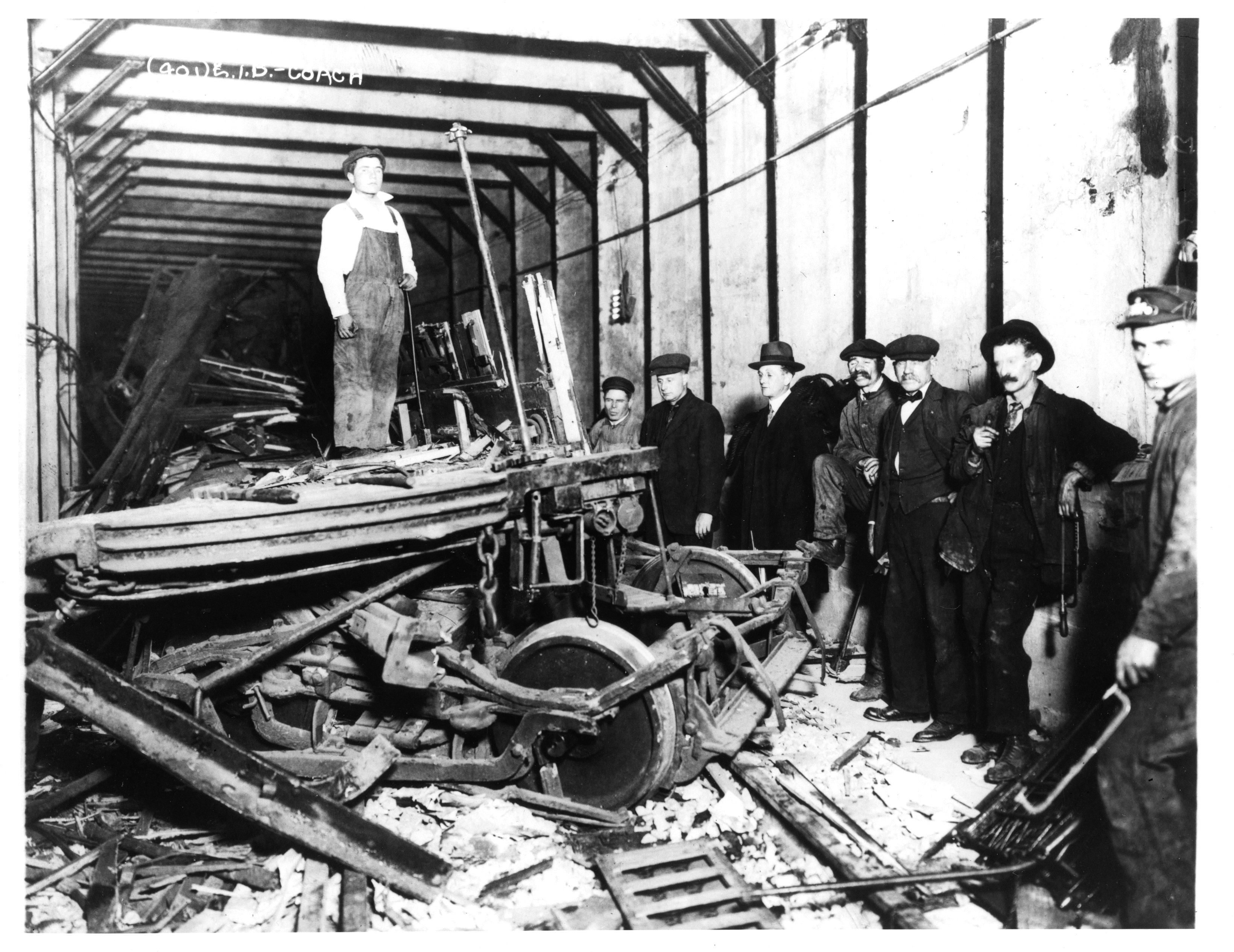 Workers and police stand among wreckage of the Malbone Street Wreck, 1918.