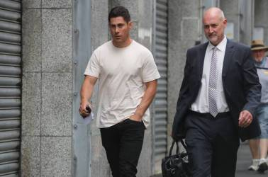 Jamie Foster leaves the Auckland District Court after being charged last year. Photo / Doug Sherring
