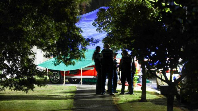 Police investigate a December 23 attack at Wattle Downs. Photo / Hayden Woodward